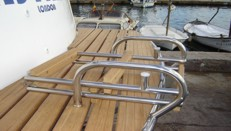 Stainless bathing platform with folding ladders